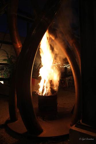 Fire Pit under Terry Karpowicz's latest sculpture