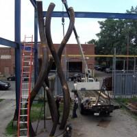 Assembly of sculpture - Erik Lowe, Adrian Calderon & Seth Goddard